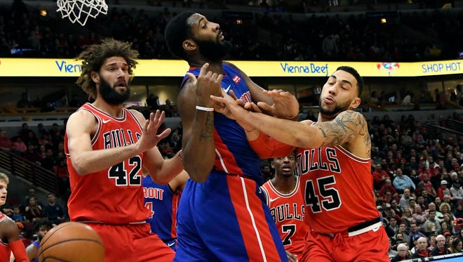 Bulls center Robin Lopez (42) forward Denzel Valentine (45) and Pistons center Andre Drummond (0) go for a loose ball during the first half on Saturday, Jan. 13, 2018, in Chicago.