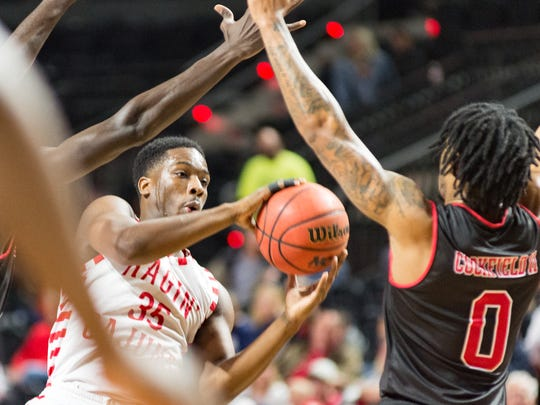 Senior point guard Marcus Stroman drives to the basket for UL against Arkansas State earlier this month.