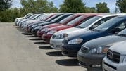 This undated photo provided by the Michigan Secretary of State shows cars lined up at an auto dealership.