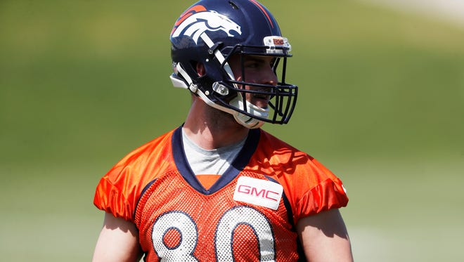 This May 13, 2017 file photo shows Denver Broncos tight end Jake Butt looking on during the team's NFL football rookie minicamp at the Broncos' headquarters in Englewood, Colo.