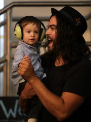 Dan Rodriguez dances with his son Oak during Cat Clyde's performance at Appleton Beer Factory during Mile of Music in August. Rodriguez will be back in town this weekend for a show at Tanners Grill and Bar in Kimberly.