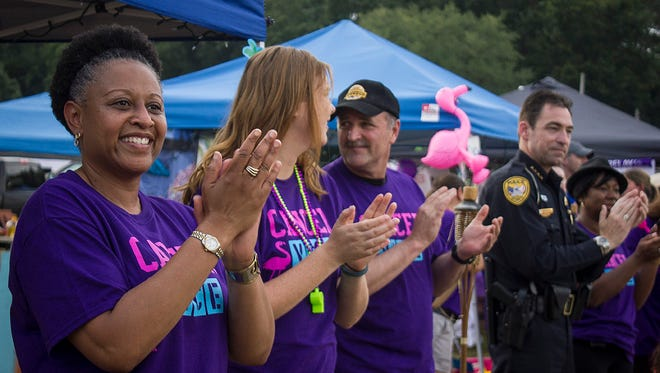 "Participants line the track and cheer on cancer survivors as they walk the ""Survivors lap"" to initiate the first lap of Relay for Life at the North Florida Fairgrounds during a previous year. There are three area relays this year, with two on April 21 and one May 13."