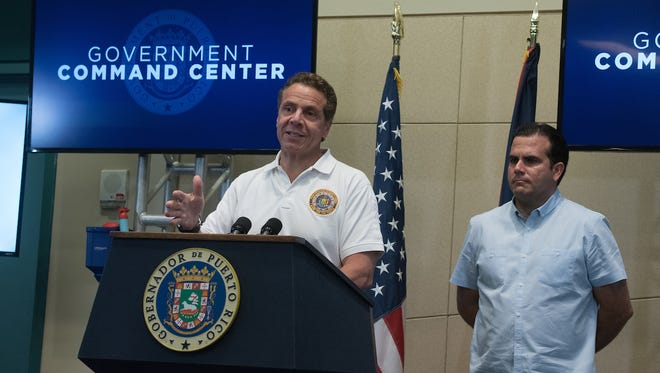Gov. Andrew Cuomo speaks Thursday, Oct. 26, 2017, with Puerto Rico Gov. Ricardo Rossello during his second visit to Puerto Rico after Hurricane Maria wrecked the island.