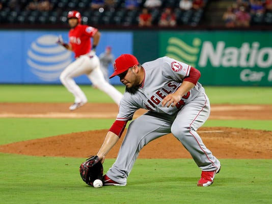 Rangers rally again, magic number 3 after beating Angels 3-2