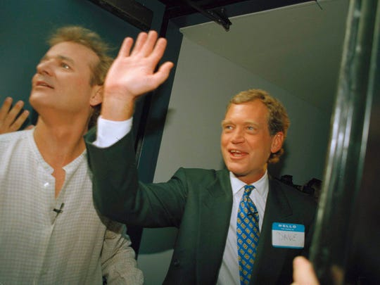 David Letterman, right, and Bill Murray wave in 1993 from the side door of the Ed Sullivan Theater in New York. Murray was a frequent guest on Letterman's show and is on Tuesday night's show.