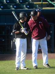 Maryland Eastern Shore's Head Coach Brian Hollamon talks to Jordan Torres during the game against La Salle on Tuesday, Feb. 27, 2018 at the Franklin Perdue Stadium in Salisbury, Md.