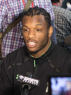 Shilique Calhoun speaks at the NFL combine. Linemates Joel Heath and Lawrence Thomas joined him at the showcase event this week.