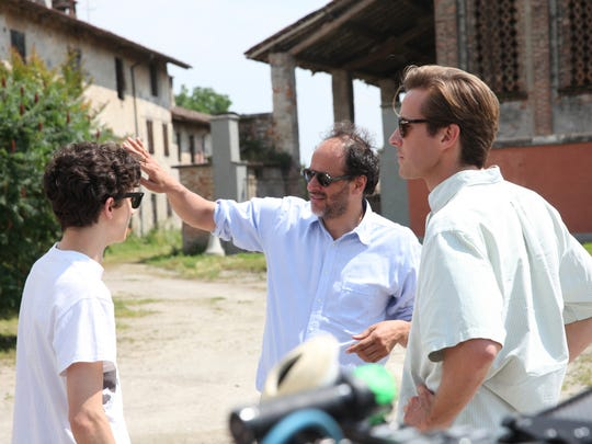 "Timothée Chalamet (from left), director Luca Guadagnino and Armie Hammer on the set of ""Call Me By Your Name."""