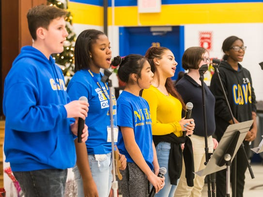Somerdale Park School's chorus performs holiday songs for the families.