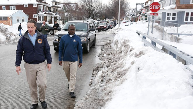 New York Gov. Andrew Cuomo, left, and Buffalo Mayor Byron Brown survey storm clean-up in the south Buffalo area on Sunday.