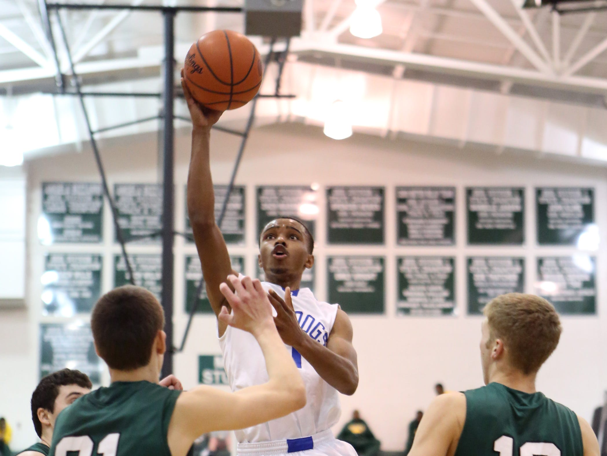 Woodward guard Isaiah Jones scores in the Division II Boys Southwest sectional playoff game between McNicholas and Woodward High School at Mason High School, March 7. McNicholas defeated Woodward 65-44.