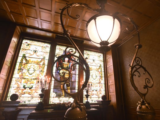 Diners are free to walk around the 52-room mansion and enjoy such details as the beveled, stained glass windows.