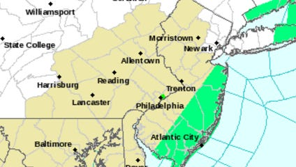 The green indicates a flood advisory. Heavy rain totaling 1 to 2 inches is possible Monday morning.