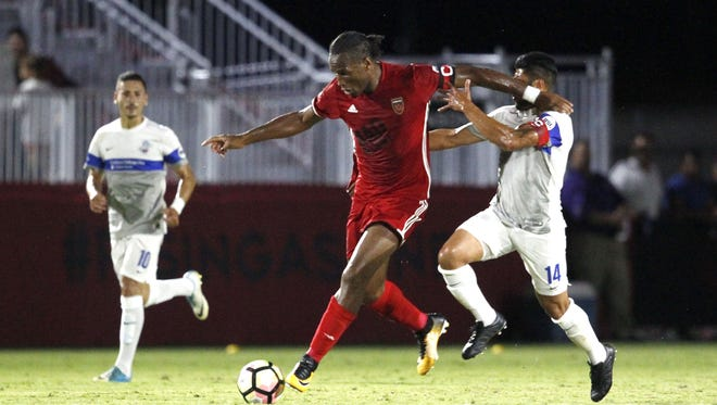 Phoenix Rising FC's Didier Drogba (11) pushes past Colorado's Rony Argueta (14) against the Colorado Springs Switchbacks FC during the first half on Saturday July 15, 2017 at Phoenix Rising FC Soccer Complex in Scottsdale, Ariz.