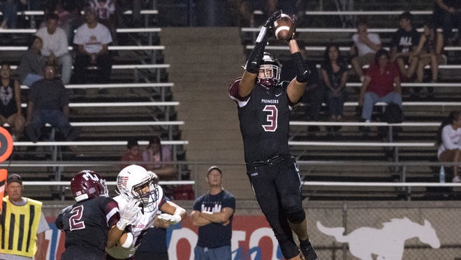 Mt. Whitney's Anthony Valencia take a pass against Tulare Western in a non-league high school football game on Friday, August 24, 2018.