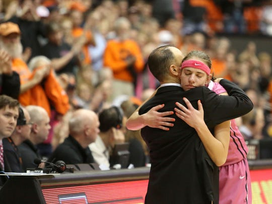 Oregon State's Sydney Wiese hugs head coach Scott Rueck in the closing seconds of their victory against Arizona State on Friday, Feb. 13 , 2015, in Corvallis, Ore.