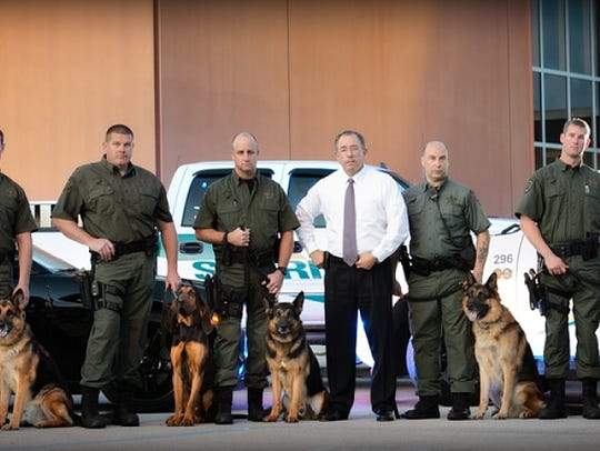 Sheriff Snyder with some of his human and canine deputies.
