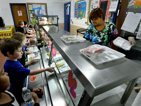 Lunchroom worker Glenda Thompson asks each South Knoxville