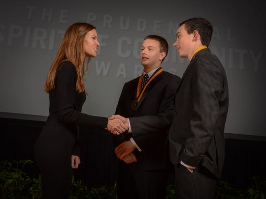 Will Kenney of Delmar (right) shakes the hand of actress and humanitarian Hillary Swank at the Prudential Spirit of Community Awards in Washington DC.