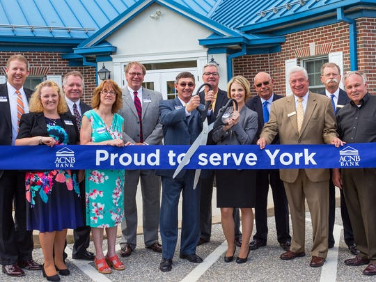 ACNB Bank recently celebrated its new South York Plaza office opening with a ribbon cutting ceremony. Pictured, from left, are: James Helt, ACNB Bank president; Claire Forbush, ACNB Bank vice president/commercial loan officer; Frank Elsner III, ACNB Corporation and ACNB Bank chairman of the board; Nancy Barry, York County Economic Alliance vice president/operations and CFO; Thomas Ritter, ACNB Corporation president/CEO and ACNB Bank CEO; Thomas Stone, executive vice president/chief community banking officer; Commissioner Chris Reilly; Amber Bowers, ACNB Bank retail office manager; John Kashner, ACNB Bank vice president/commercial loan officer; Donald McVay, ACNB Bank vice president/commercial loan officer; Scott Kelley, esquire and ACNB Corporation and ACNB Bank board member; and Commissioner Doug Hoke.