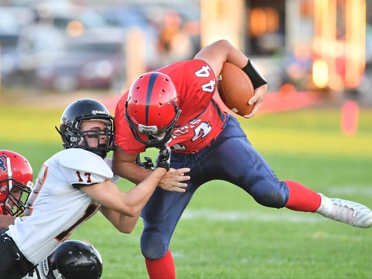Stanley-Boyd's Brandon Milas tackles Spencer-Columbus's Hunter Luepke during a Cloverbelt Conference matchup last fall.