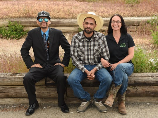 David Decker, left, Josh White, center and his wife Terra White sit outside the tribal office in Elko, Nevada on May 19, 2017. David Decker is VP of the Inter-Tribal Council of Nevada and chairman of the Elko Band Council. The Whites own Cannabis Consulting Group INC, a professional consulting services on all aspects of the marijuana industry.