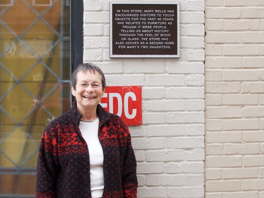 """Chloe Bass, """"The Book of Everyday Instruction, Chapter Three: We walk the world two by two (Mary),"""" bronze coated aluminum plaque permanently installed on Mary's story in Greensboro."""