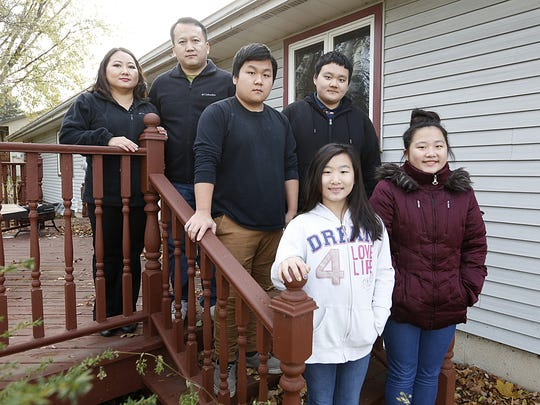 Ger Xiong (far left) has support from her family as she await a kidney donor. Sunday November 12, 2017. Next to Ger is her husband Jia, and their children. Vichai and Sensai (middle row) Daranee and Ashley (front row). DougRaflik/USA TODAY NETWORK-Wisconsin