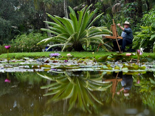 """""""It's the waterlily festival so I feel sort of compelled to give it a shot,"""" said painter Sean Sexton June 17, 2017, during the 13th annual Waterlily Celebration at McKee Botanical Garden in Vero Beach. The garden is part of the Trolley Historical Tours of Vero Beach."""