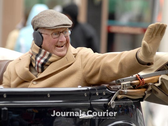 By Brent Drinkut/Journal & Courier -- Co-Grand Marshal Jim Shook waves to the crowd during the 2009 Lafayette - West Lafayette Christmas Parade on Sunday, December 6, 2009.