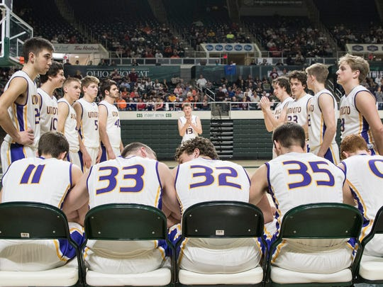 Unioto's starting five, (from left to right) Brandon Kennedy, Gabe Fisher, Chance Smith, Peyton Hill and Logan Swackhammer prepare for pregame introductions Thursday night at Ohio University's Convocation Center.