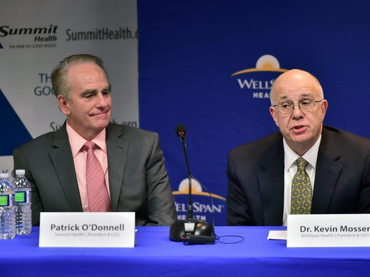 Patrick O'Donnell, left, CEO/President Summit Health and Dr. Kevin Mosser, WellSpan, CEO/President hold a press conference on Tuesday, April 3, 2018 at Chambersburg Hospital. Summit Health and WellSpan Health are working towards a potential affiliation.