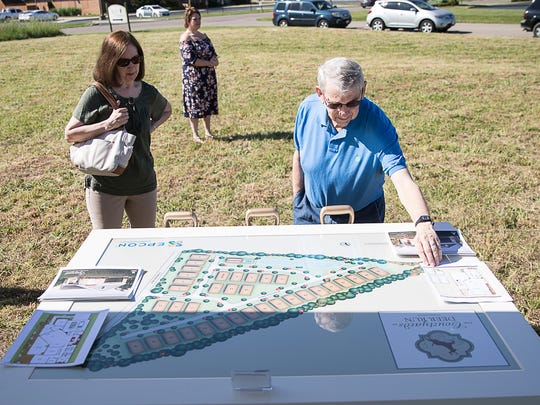 "Danny Hougland, right, and his wife Pat look at the layout plans at the groundbreaking ceremony for The Courtyards at Deer Run, a new luxury condominium complex, on May 24, 2018, in Chillicothe, Ohio. ""We look forward to only being on ground level and not having to worry about lawn care,"" said Pat Hougland, who has already put a deposit down on a home in the complex with her husband."
