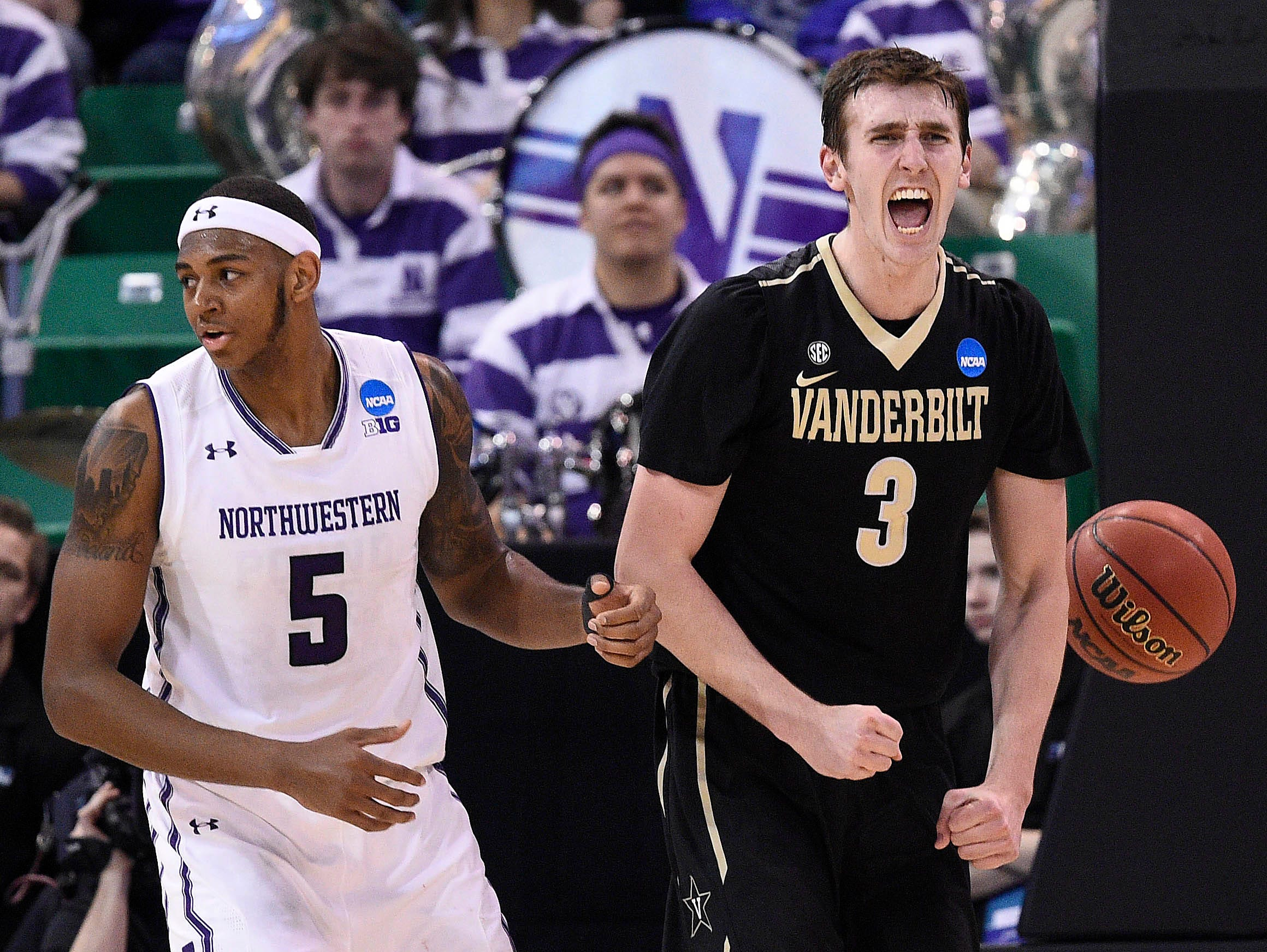 Vanderbilt forward Luke Kornet (3) reacts in front of Northwestern center Dererk Pardon (5) during the first half of the NCAA tournament first-round game in Salt Lake City on March 16, 2017.