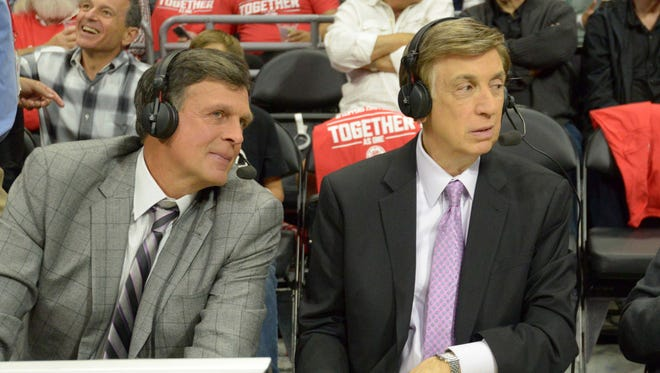 Kevin McHale and Marv Albert talk during game two of the first round of the NBA playoffs.