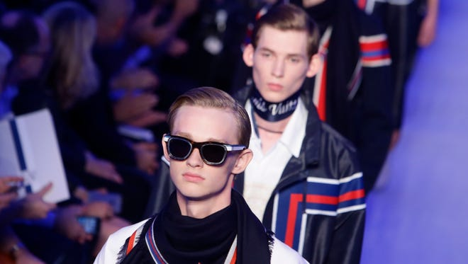 Models wear creations for Louis Vuitton's men Spring-Summer 2016 fashion collection presented, Thursday, June 25, 2015 in Paris, France.