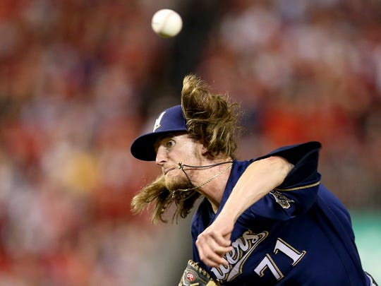 Milwaukee Brewers relief pitcher Josh Hader (71) pitches during the eighth inning of a National League wild-card baseball game against the Washington Nationals at Nationals Park, Tuesday, Oct. 1, 2019, in Washington. (AP Photo/Andrew Harnik)