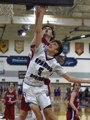 Spanish Springs' Brock O'Connell goes up to shoot with Reno's Tommy Challis covering him during Tuesday's game at Spanish Springs.
