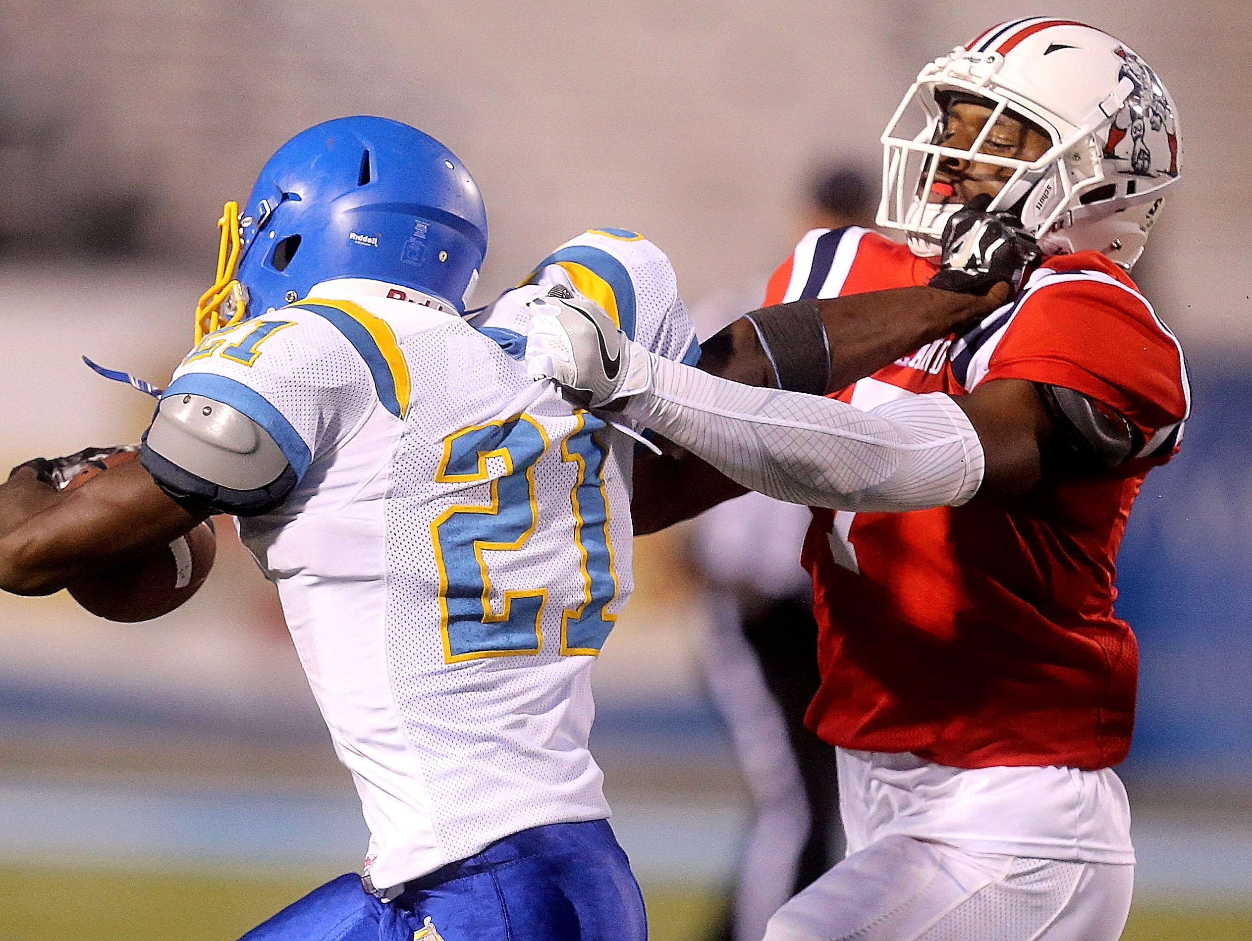 Oakland's Jacoby Stevens (7) brings down Jackson North Side's Darius Brown (21) last week's game at MTSU.