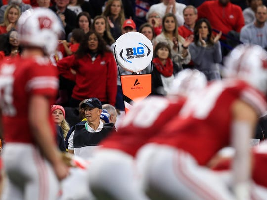 Dec 7, 2019; Indianapolis, IN, USA; A view of the Big Ten logo on a sideline marker as the Wisconsin Badgers offense takes the field against the Ohio State Buckeyes defense during the first half in the 2019 Big Ten Championship Game at Lucas Oil Stadium. Mandatory Credit: Aaron Doster-USA TODAY Sports