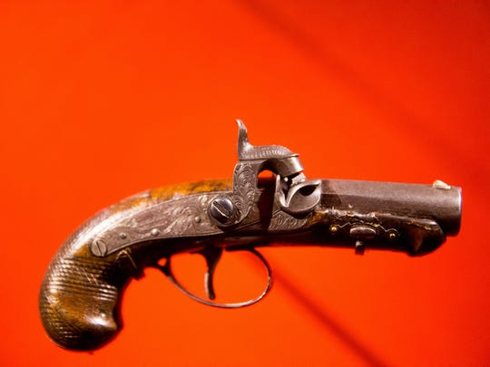John Wilkes Booth's pistol used to kill President Abraham Lincoln is displayed at an exhibit at the Ford's Center for Education and Leadership.