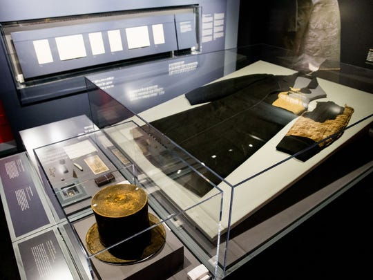 President Abraham Lincoln's top hat, Brooks Brothers Coat, and and items from his pockets from the night of his assassination are displayed at the Ford's Center for Education and Leadership in Washington, D.C.