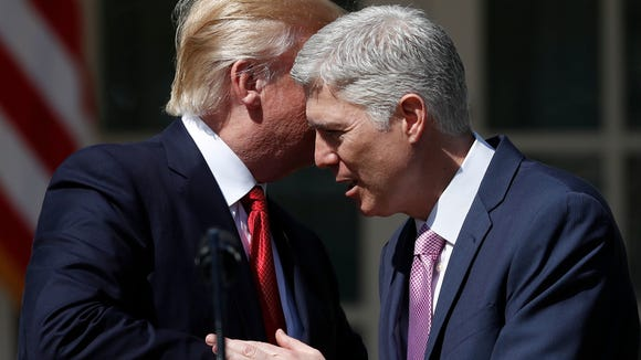 President Trump and Neil Gorsuch in July.