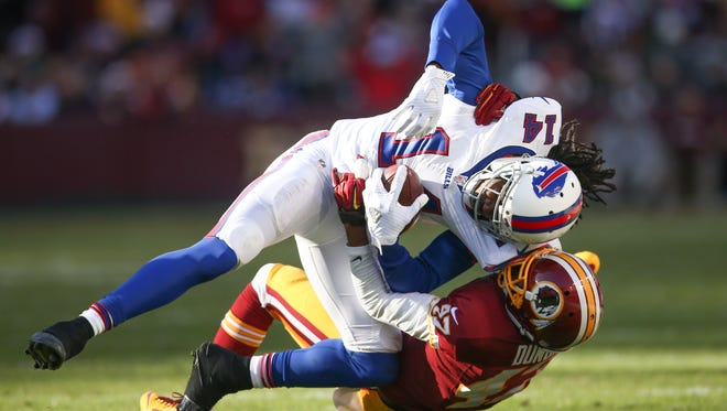 Buffalo Bills wide receiver Sammy Watkins (14) is tackled by Washington Redskins cornerback Quinton Dunbar (47) during the first half of an NFL football game in Landover, Md., Sunday, Dec. 20, 2015. (AP Photo/Andrew Harnik)