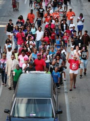 Nearly 200 demonstrators walk to City Hall from Church