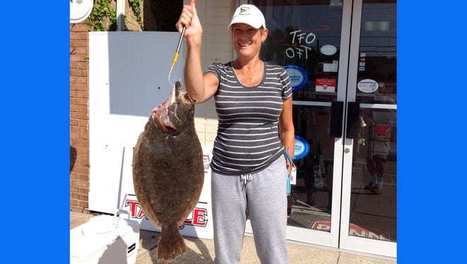 Maria Byrnes with a 6 pound flounder that she recently landed.
