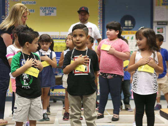 Kindergartners say the Pledge of Allegiance during