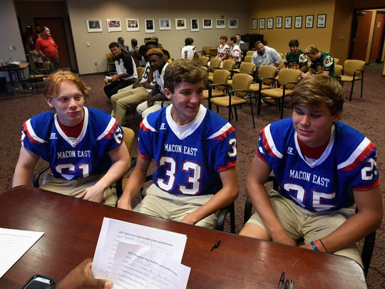 Macon East players are interviewed during the Montgomery