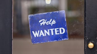 Closeup of a help-wanted sign.