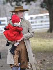 On Dec. 13, 2014, Michael Agee carried his daughter,